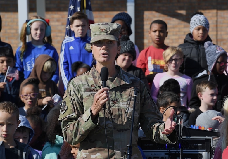 U.S. Air Force Col. Heather Blackwell, 81st Training Wing commander, delivers remarks during a Jeff Davis Elementary School Veterans Day celebration in Biloxi, Mississippi, Nov. 15, 2019. During the event, students also recited the Pledge of Allegiance. Keesler Air Force Base leadership and base personnel attended the event. (U.S. Air Force photo by Kemberly Groue)
