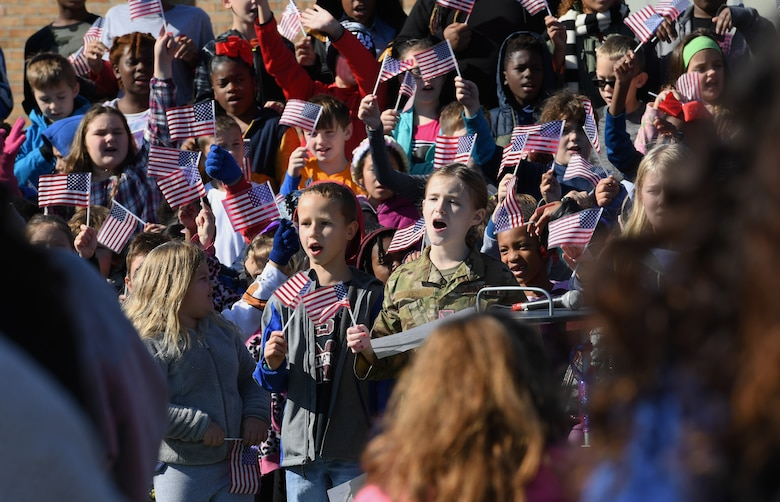 Students at Jeff Davis Elementary School sing patriotic songs during a Veterans Day celebration in Biloxi, Mississippi, Nov. 15, 2019. During the event, students also recited the Pledge of Allegiance. Keesler Air Force Base leadership and base personnel attended the event. (U.S. Air Force photo by Kemberly Groue)