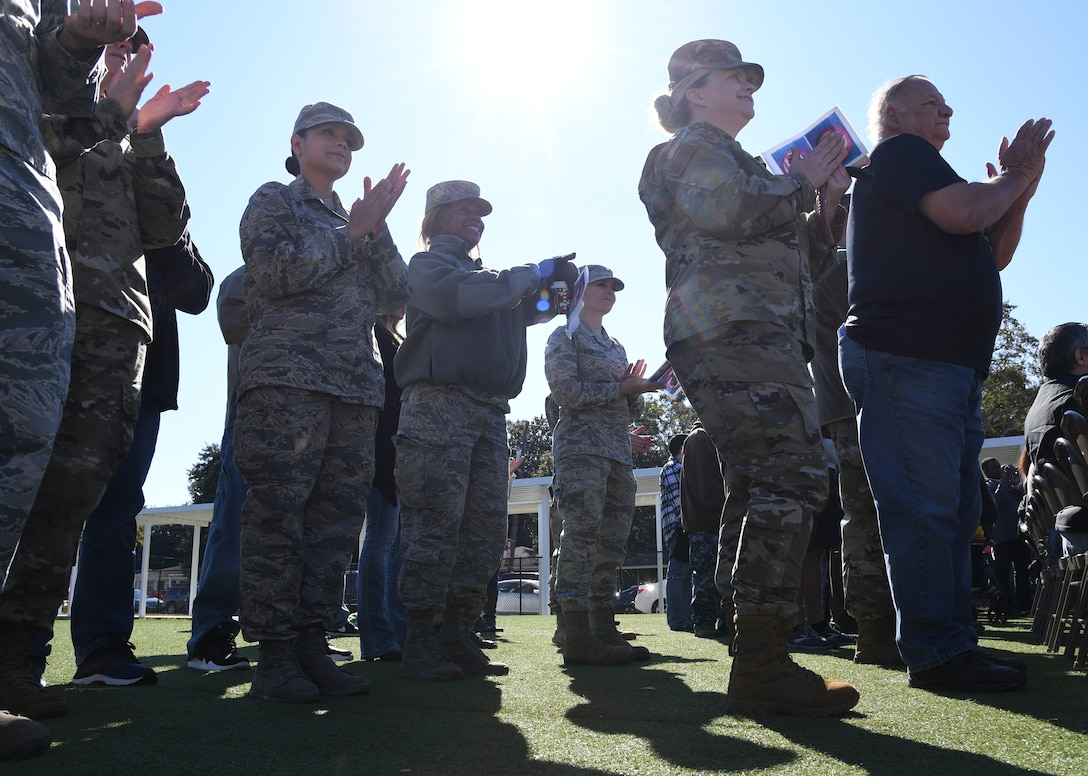 Keesler Air Force Base personnel and family members attend the Jeff Davis Elementary School Veterans Day celebration in Biloxi, Mississippi, Nov. 15, 2019. During the event, students also recited the Pledge of Allegiance. Keesler Air Force Base leadership and base personnel attended the event. (U.S. Air Force photo by Kemberly Groue)