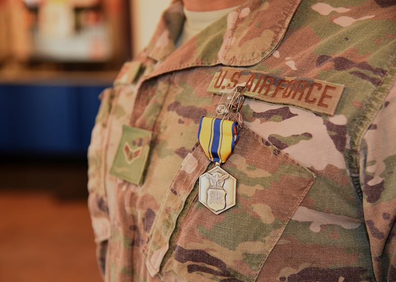 Airman 1st Class Christian Reid, 790th MSFS Defender, displays his recently earned Air Force Commendation Award l during a ceremony Nov. 15, 2019, at the Base Theater on F. E. Warren Air Force Base, Wyo. Horton received the commendation for actions taken in rescuing a family in danger of a house fire Nov. 7 in Dix, Nebraska. Reid was recognized alongside his teammate, Airman 1st Class Christopher Horton. (Air Force photo by Glenn S. Robertson)