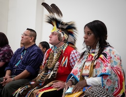 Red Road Awareness performers Fred Keams, Joshua McMinn, and Nina Fox,  listen to guest speaker Chief Matthew Black Eagle Man during the Fort Knox National American Indian Heritage Month Observance, hosted by 1st Theater Sustainment Command at Saber and Quill on Fort Knox, Ky., Nov. 15, 2019.