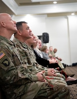 Distinguished guests hold their braids of sweet grass while listening to a speech delivered by the guest speaker Chief Black Eagle Man during the Fort Knox National American Indian Heritage Month Observance hosted by 1st Theater Sustainment Command on Fort Knox, Ky., Nov. 15, 2019.