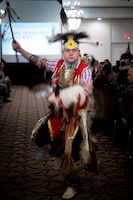 Joshua McMinn of Red Road Awareness, performs a traditional men's dance during the Fort Knox National American Indian Heritage Month Observance at Saber and Quill on Fort Knox, Ky. on Nov. 15, 2019.