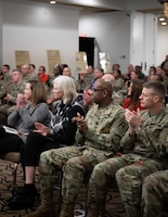 Distinguished guests clap after a performance during the Fort Knox National American Indian Heritage Month Observance held at Saber and Quill on Fort Knox, Ky. Nov. 15, 2019.