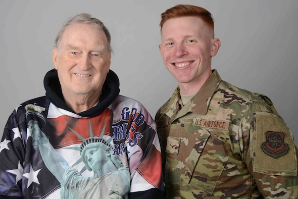 U.S. Air Force Retired Staff Sgt. Galen Eberhardt and his grandson, Airman 1st Class Douglas Bosarge, 22nd Operations Support Squadron airfield management shift lead, pose for a photo Nov. 13, 2019, at McConnell Air Force Base, Kan. Eberhardt was stationed at McConnell from 1970 to 1975, while Bosarge arrived at McConnell in 2018. (U.S. Air Force photo by Airman 1st Class Alexi Bosarge)