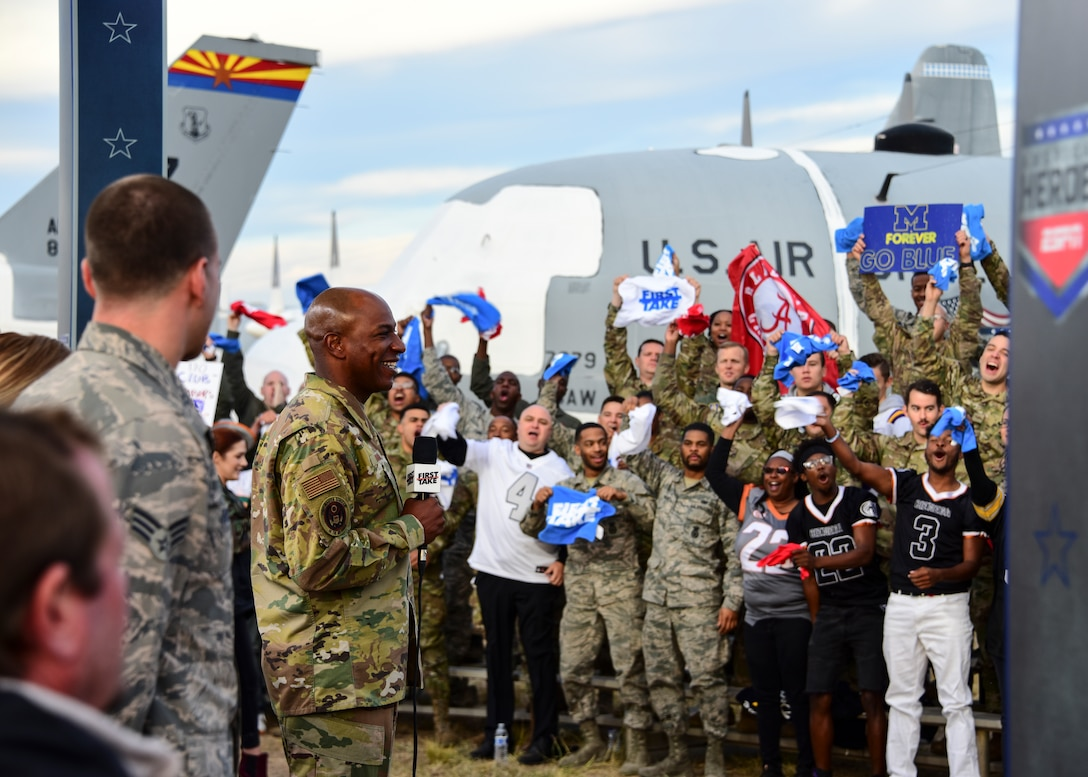 """Airmen, family, and veterans cheer during ESPN's """"First Take""""  featuring CMSAF."""
