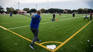 Airmen play a game of whiffle ball