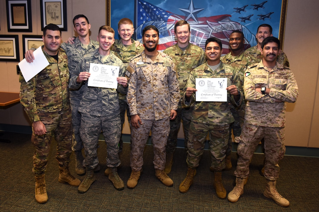 An Airfield Operations Officer Course class poses for a picture during an Airfield Operations Officer Course graduation inside the Dempsey Conference Room inside Cody Hall at Keesler Air Force Base, Mississippi, Nov. 8, 2019. U.S. Air Force 2nd Lt. Kiefer Luth, 57th Operations Support Squadron, Nellis Air Force Base, Nevada, airfield operations officer, recently completed the course and graduated in the room dedicated to his grandfather, retired Col. Derrel Dempsey. The room was dedicated to Dempsey to honor his military accomplishments. (U.S. Air Force photo by Airman Seth Haddix)