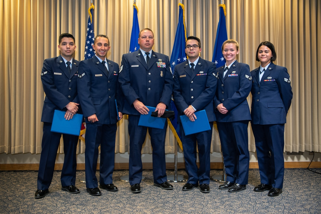 SCHRIEVER AFB, Colo. - Team Schriever Community College of the Air Force graduates after receiving their diplomas, at Schriever Air Force Base, Colorado, Nov. 14,2019. The CCAF, through the Air University, was established in 1972 for Airmen to gain academic accreditation for training receiving in Air Force technical schools. ( U.S. Air Force photo by Kathryn Calvert)