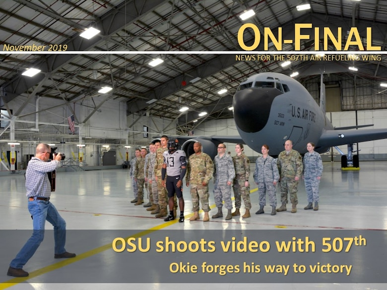 An Oklahoma State University video crew visits the 507th Air Refueling Wing and takes footage of their military appreciation uniform with and in a KC-135R Stratotanker Oct. 9, 2019, at Tinker Air Force Base, Oklahoma. (U.S. Air Force image by Tech. Sgt. Samantha Mathison)