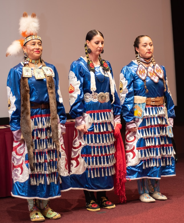 Three members of the Native American Women Warriors stand together at the National American Indian Heritage Month observance at Redstone Arsenal, Alabama, Nov. 13, 2019. From right to left: Army veteran Keshon Smith; Marine Corps veteran Carrie Lewis; and Army veteran Mitchelene BigMan, president and founder of NAWW. The observance was organized by Huntsville Center's Equal Employment Opportunity office in coordination with Team Redstone and the U.S. Army Aviation and Missile Command. The Native American Women Warriors are an all-female group of Native American veterans who started as a color guard but have since grown and branched out as advocates for Native American women veterans in areas such as health, education and employment. The members make appearances at various events around the country, serving as motivational and keynote speakers, performing tribal dances, and fulfilling the role of color guard representing all branches of the U.S. military.