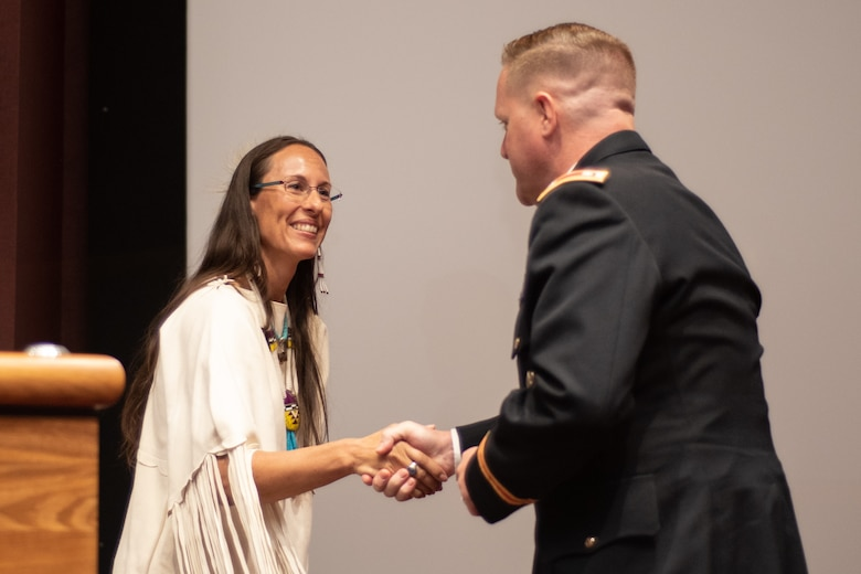 Lt. Col. H. W. Hugh Darville, deputy commander of Huntsville Center, thanks Dr. Yvette Running Horse Collin for speaking during the National American Indian Heritage Month observance at Redstone Arsenal, Alabama, Nov. 13, 2019. The observance was organized by Huntsville Center's Equal Employment Opportunity office in coordination with Team Redstone and the U.S. Army Aviation and Missile Command. Sacred Way Sanctuary is an education and research facility in Florence, Alabama, dedicated to preserving the Native American horse and other animals sacred to indigenous peoples of the Americas.