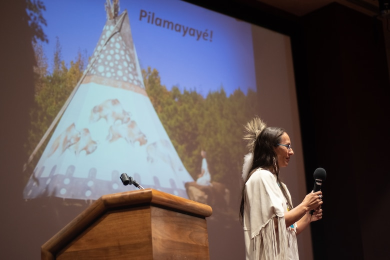 """Dr. Yvette Running Horse Collin, co-founder of Sacred Way Sanctuary, tells the audience Pilamayaye (""""thank you"""" in Lakota) after her keynote address during the National American Indian Heritage Month observance at Redstone Arsenal, Alabama, Nov. 13, 2019. The observance was organized by Huntsville Center's Equal Employment Opportunity office in coordination with Team Redstone and the U.S. Army Aviation and Missile Command. Sacred Way Sanctuary is an education and research facility in Florence, Alabama, dedicated to preserving the Native American horse and other animals sacred to indigenous peoples of the Americas."""