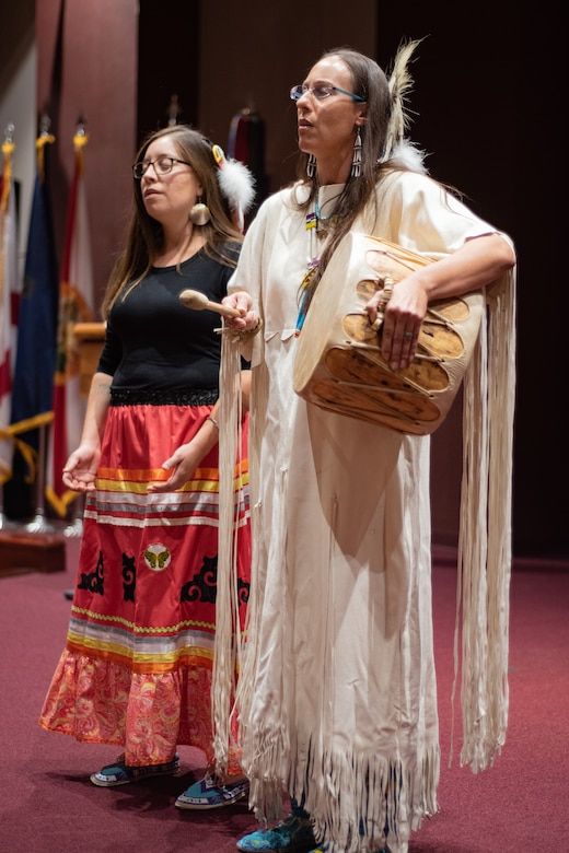 Dr. Yvette Running Horse Collin, right, and Jacquelyn Córdova, guests from Sacred Way Sanctuary in Florence, Alabama, share music with attendees of Huntsville Center's National American Indian Heritage Month observance at Redstone Arsenal, Alabama, Nov. 13, 2019. Sacred Way Sanctuary is an education and research facility dedicated to preserving the Native American horse and other animals sacred to indigenous peoples of the Americas.