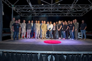 The Edwards AFB TEDx team pose for a group photo at the Benefield Anechoic Facility on Edwards Air Force Base, California, Nov. 12. (Air Force photo by Richard Gonzales)
