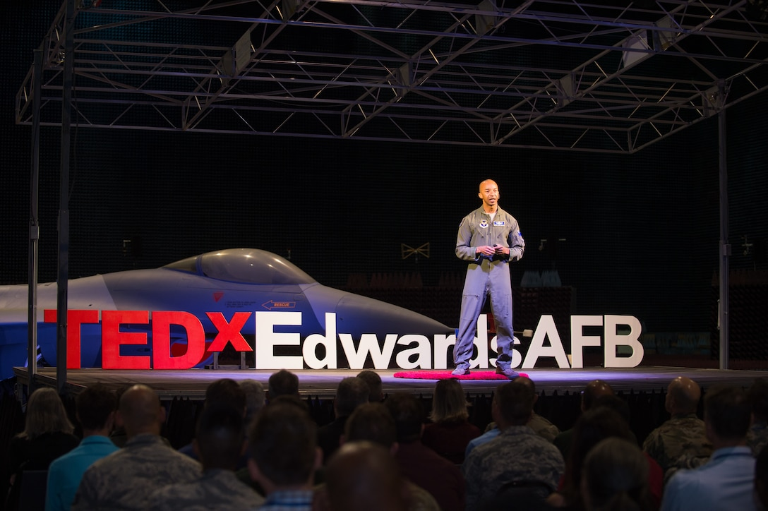 "Col. Randy ""Laz"" Gordon, Lead for the Secretary of the Air Force's AI Technology Accelerator, talks to guests during a presentation at the Edwards Air Force Base first-ever TEDx talks in the Benefield Anechoic Facility at Edwards AFB, California, Nov. 12. Gordon shared his experiences on innovation, implementation and breaking barriers while serving in the Air Force. Technology, Entertainment, and Design (TED) is a nonpartisan nonprofit devoted to spreading ideas, usually in the form of short, powerful talks. Meanwhile, TEDx events are organized independently under a free license granted by TED, according to the TED website. (Air Force photo by Richard Gonzales)"