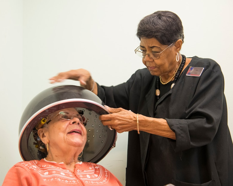Lucy Richardson started working in the Randolph Air Force Base beauty salon 50 years ago and overcame prejudices of the time.