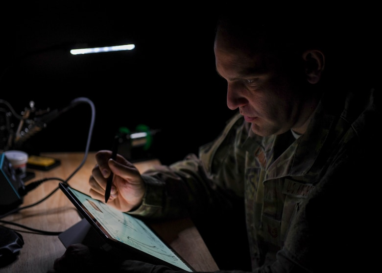 U.S. Air Force Tech. Sgt. Daniel Caban, 1st Aircraft Maintenance Squadron crew chief, creates a draft in the Innovation Cell Lab at Joint Base Langley-Eustis, Virginia, Nov. 5, 2019.