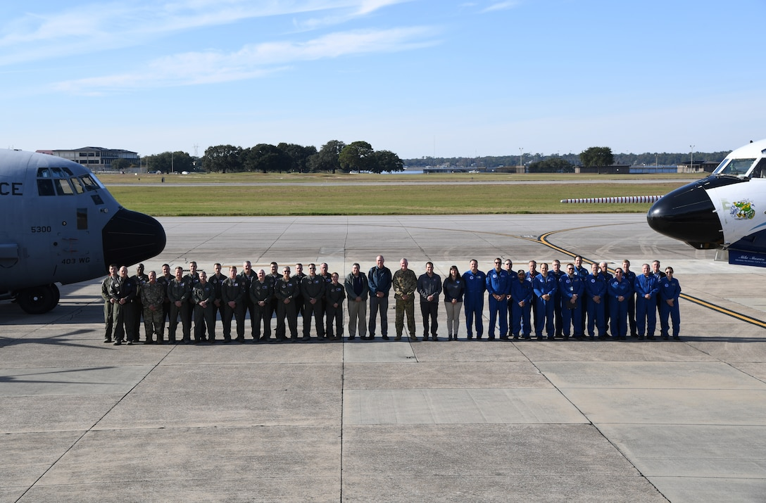 Members from the 53rd Weather Reconnaissance Squadron National Oceanic and Atmospheric Administration, National Hurricane Center, National Center for Atmospheric Research and the Chief, Aerial Reconnaissance Coordination, All Hurricanes pose for a group photo Nov. 13, 2019 on the flightline at Keesler, Air Force Base, Miss.