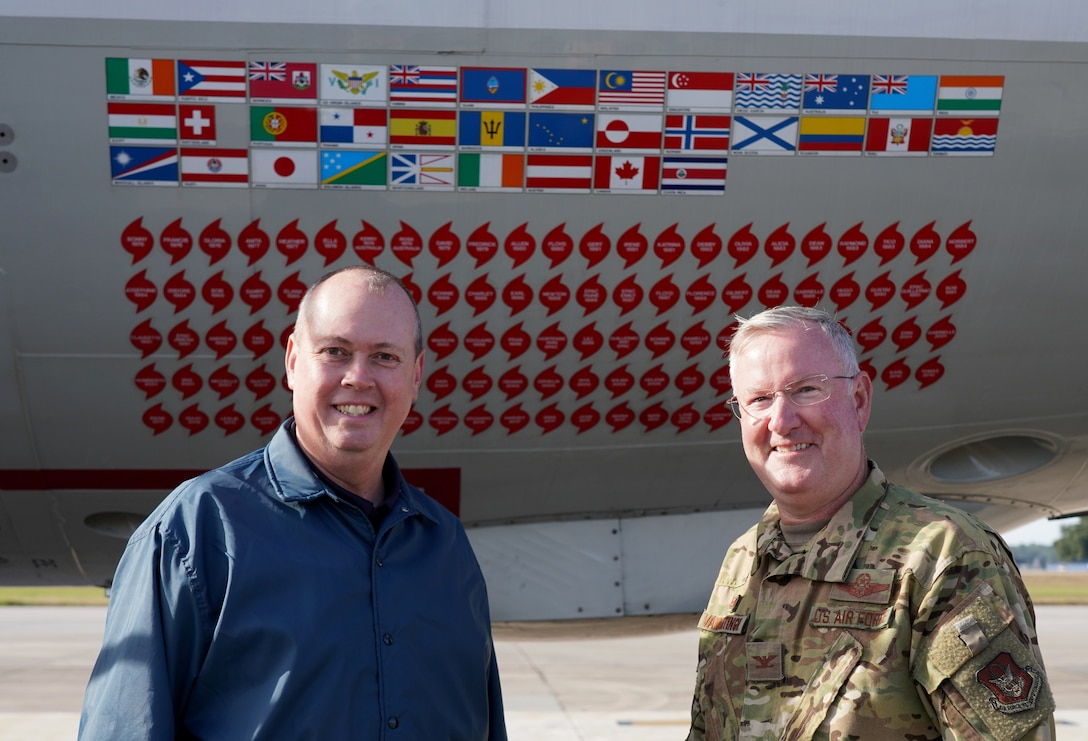 Ken Graham, director of the National Hurricane Center in Miami, and Col. Jeffrey A. Van Dootingh, 403rd Wing commander, pose for photo in front of a WP-3D Orion at Keesler Air Force Base Nov. 13, 2019. The aircraft is used by the National Oceanic and Atmospheric Administration's Aircraft Operations Center Hurricane Hunters to fly into hurricanes. (U.S. Air Force photo by Senior Airman Kristen Pittman)