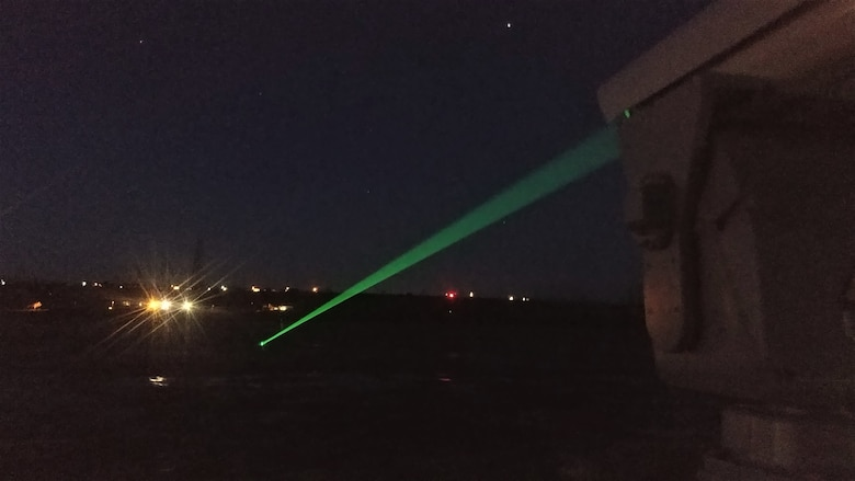 Photo of green laser shining at night