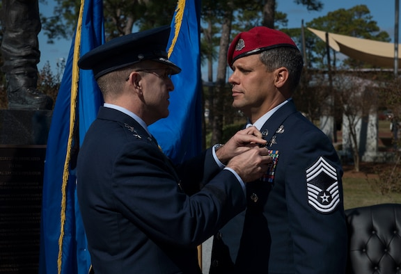 Lt. Gen. Jim Slife, commander of Air Force Special Operations Command, pins the Silver Star Medal on Chief Master Sgt. Chris Grove, the 720th Special Tactics Group superintendent and special tactics combat controller, during a ceremony at Hurlburt Field, Fla., Nov. 15, 2019. Grove was awarded the nation's third-highest personal decoration for valor in combat for his actions while deployed to Afghanistan in November 2007. (U.S. Air Force photo by Senior Airman Rachel Williams)