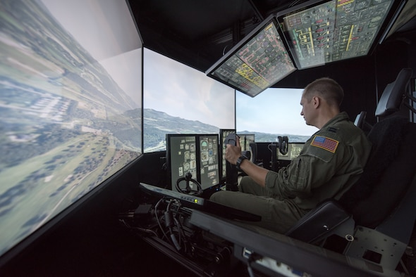 Capt. Tristan Stonger, a pilot from the Kentucky Air National Guard's 165th Airlift Squadron, uses a C-130 simulator for training at the Kentucky Air National Guard Base in Louisville, Ky., Aug. 28, 2019. Known as the Multi-Mission Crew Trainer, the system helps prepare Airmen for handling in-flight emergencies. (U.S. Air National Guard photo by Phil Speck)