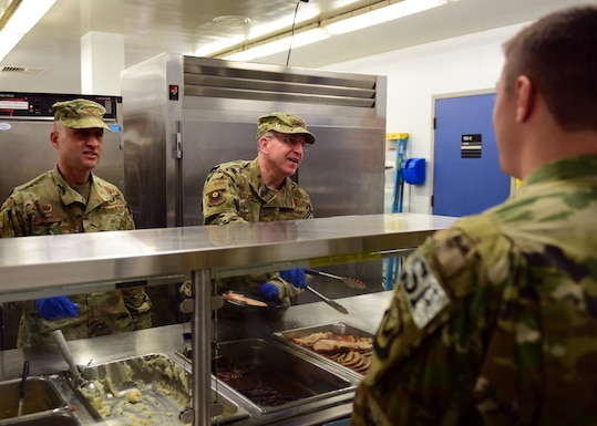 U.S. Air Force Lt. Gen. Jim Slife, right, commander of Air Force Special Operations Command and Col. Terrence Koudelka, commander of the 193rd Special Operations Wing, Pennsylvania Air National Guard, serve Thanksgiving lunch to Airmen, Nov. 16, 2019 at the 193rd SOW, Middletown, Pennsylvania.
