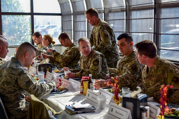 U.S. Air Force Lt. Gen. Jim Slife, center, commander of Air Force Special Operations Command, has lunch with Airmen at the 193rd Special Operations Wing Nov. 16, 2019, in Middletown, Pennsylvania.