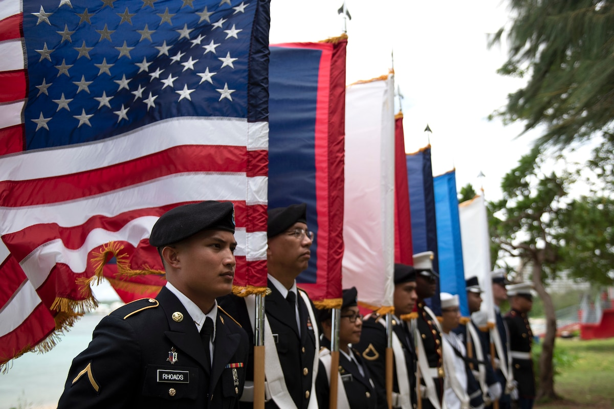 Members of a joint color guard stand in formation.