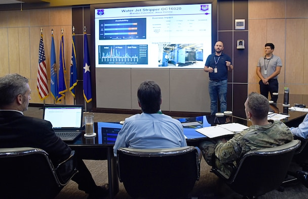 An image of a briefing from the 76th Maintenance Support Group, explaining the impact of a water jet stripper and how it contributes to cost effective readiness