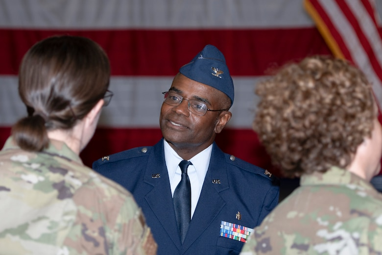 Photo of Col. Dennis Britten greeting well-wishers during change of command ceremony.