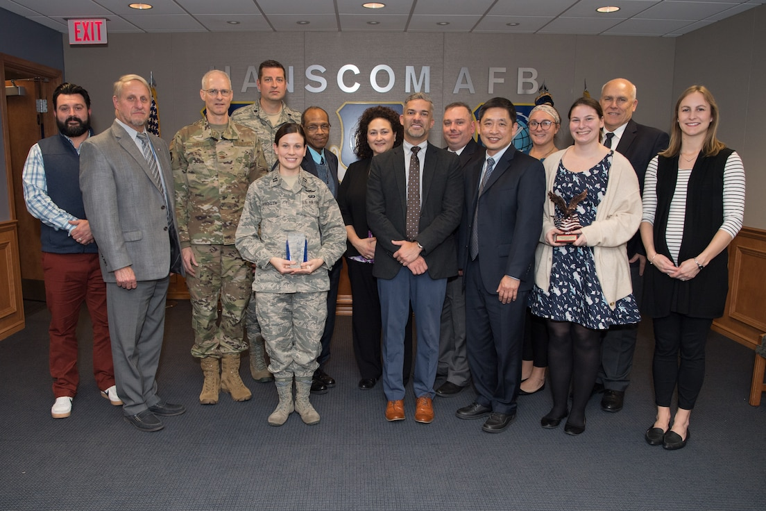 Col. Ryan Mantz, deputy program executive officer for Digital, poses for a picture with his directorate's winners and nominees of the Air Force Life Cycle Management Center's 2019 Acquisition Management Award's after the ceremony, Hanscom Air Force Base, Mass., Nov. 14. All of Hanscom's winners and nominees had won their categories at the local level before competing against their colleagues at this final level. (U.S. Air Force photo by Jerry Saslav)
