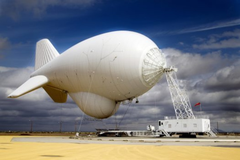 A large blimp tethered to the ground.