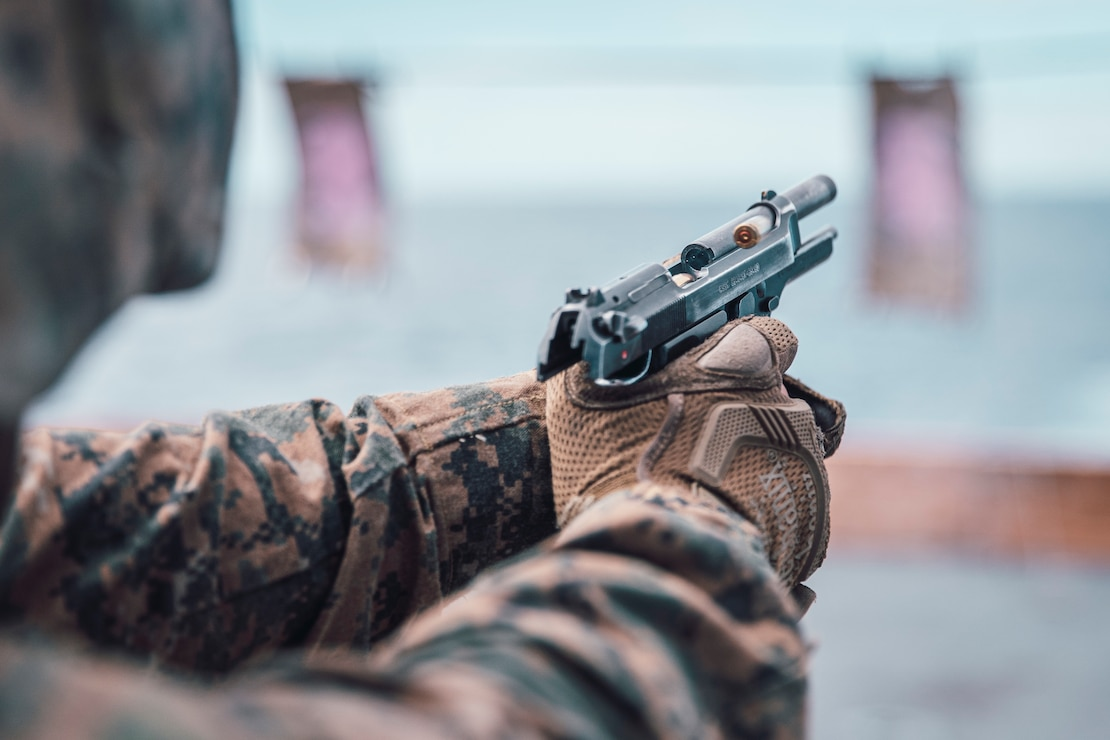 U.S. Marine Corps Sgt. Benjamin Westmoreland, a chief scout sniper with Weapons Company, Battalion Landing Team 3/5, 11th Marine Expeditionary Unit, fires an M9 pistol during a small arms range aboard the San Antonio-class amphibious transport dock ship USS John P. Murtha. The Marines and Sailors of the 11th MEU are conducting routine operations as part of the Boxer Amphibious Ready Group in the eastern Pacific Ocean.