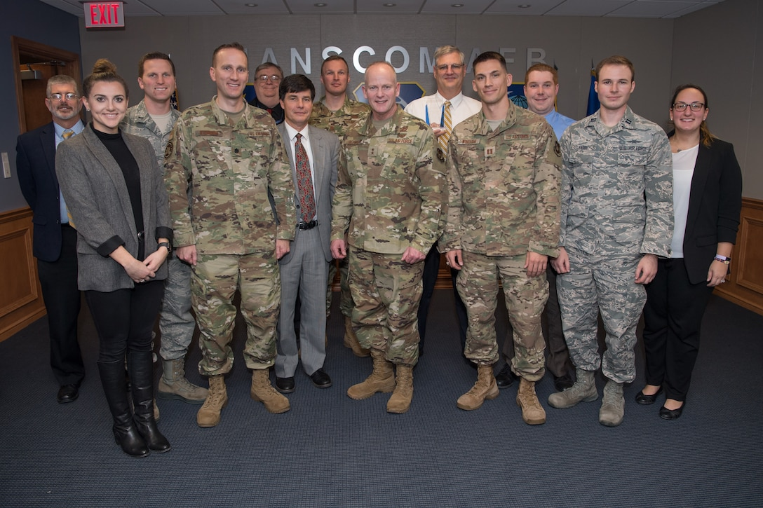 Maj. Gen. Michael Schmidt, program executive officer for Command, Control, Communications, Intelligence and Networks, poses for a picture with his directorate's winners and nominees of the Air Force Life Cycle Management Center's 2019 Acquisition Management Award's after the ceremony, Hanscom Air Force Base, Mass., Nov. 14. All of Hanscom's winners and nominees had won their categories at the local level before competing against their colleagues at this final level.