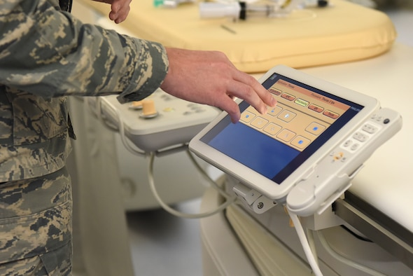 U.S. Air Force Staff Sgt. Matthew Slaven, 81st Medical Operations Squadron cardiopulmonary technician, demonstrates the capabilities of new medical equipment during the cardiac catheterization laboratory ribbon cutting ceremony inside Keesler Medical Center at Keesler Air Force Base, Mississippi, Nov. 15, 2019. The lab was upgraded with an entire suite of technology to provide better and safer care for patients and the surgical team. (U.S. Air Force photo by Senior Airman Suzie Plotnikov)