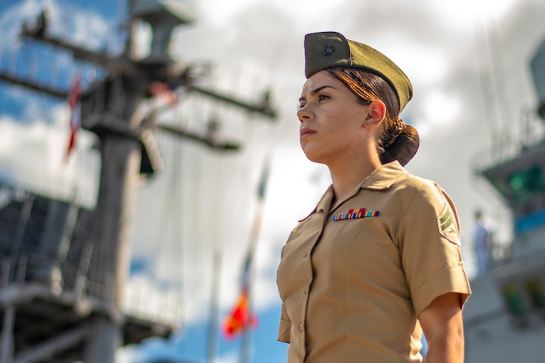 A Marine stands on a ship.