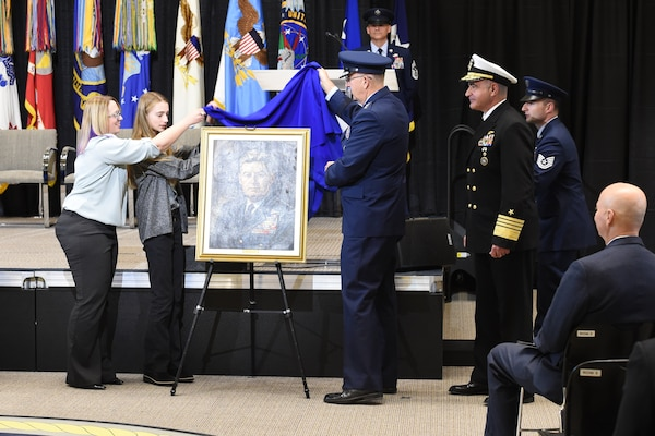 U.S. Air Force Gen. John E. Hyten, commander of U.S. Strategic Command (USSTRATCOM), unveils a portrait of U.S. Air Force Gen. Curtis E. LeMay during a building dedication ceremony held at Offutt Air Force Base, Neb, Nov. 18, 2019. USSTRATCOM dedicated its new command and control facility to LeMay, which is the heart of the Department of Defense's nuclear command, control, and communications enterprise. (U.S. Air Force photo by Staff Sgt. Ian Hoachlander)