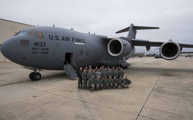 U.S. Air Force Academy Cadets with the 23rd Cadet Squadron pose for a photo in front of a C-17 Globemaster III during a tour of the 305th Air Mobility Wing on Joint Base McGuire-Dix-Lakehurst, New Jersey, Nov. 17, 2019. The 305th AMW is the 23rd CS sponsor for 2019 which allows the cadets to visit their sponsoring wing and learn about different career paths available for their future as officers. The Academy allots a day and a half for cadets to be excused from school for educational sponsor trips. (U.S. Air Force photo by Airman 1st Class Ariel Owings)