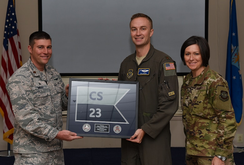 "Maj. Daniel Moore, 23rd Cadet Squadron commanding air officer, gifts a framed 23rd CS flag to Maj. Chase Bradley, 305th Air Mobility Wing chief of Commanders Action Group, and Col. Jacqueline Breeden, 305th AMW commander for putting together a visit for the cadets on Joint Base McGuire-Dix-Lakehurst, New Jersey, Nov. 17, 2019. The 305th AMW sponsors the squadron and hosts the cadets approximately every other year for education on how the enlisted force contributes to Air Force operations and what opportunities are available to the cadets after they graduate. ""The Wing really rolled out all the stops for us,"" said Moore. ""It was so well planned, everyone we met was so professional, so sharp and each embodied the 'Can Do' attitude. We couldn't be more grateful. I think, for myself and the cadets, we walked away with a better understanding of the Wing, the mission and the Airmen."" (U.S. Air Force photo by Airman 1st Class Ariel Owings)"