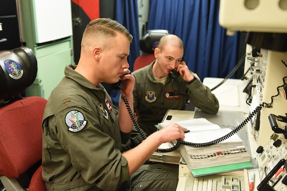 Second Lt. Clay Barnard, 12th Missile Squadron intercontinental ballistic missile combat crew deputy, and 2nd Lt. Joseph Stroup, 12th Missile Squadron ICBM combat crew commander, work in a launch control center Nov. 15, 2019, near Malmstrom Air Force Base, Mont.