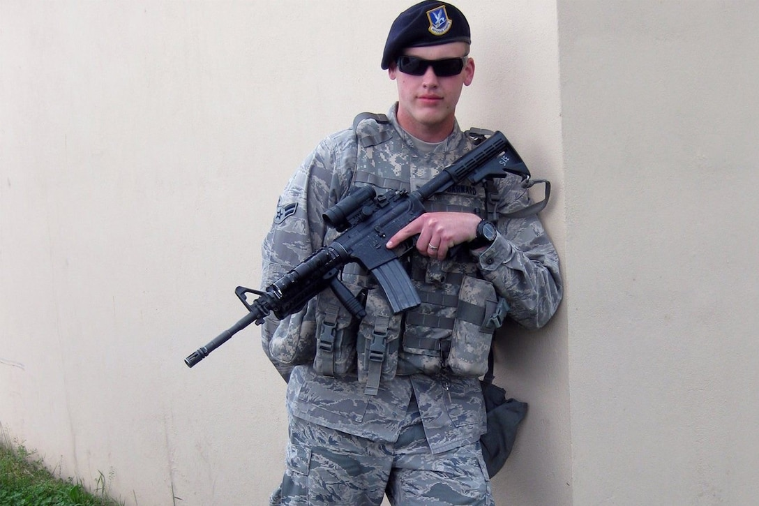 Then Airman 1st Class Clay Barnard, formerly a security forces member, poses for a photo.