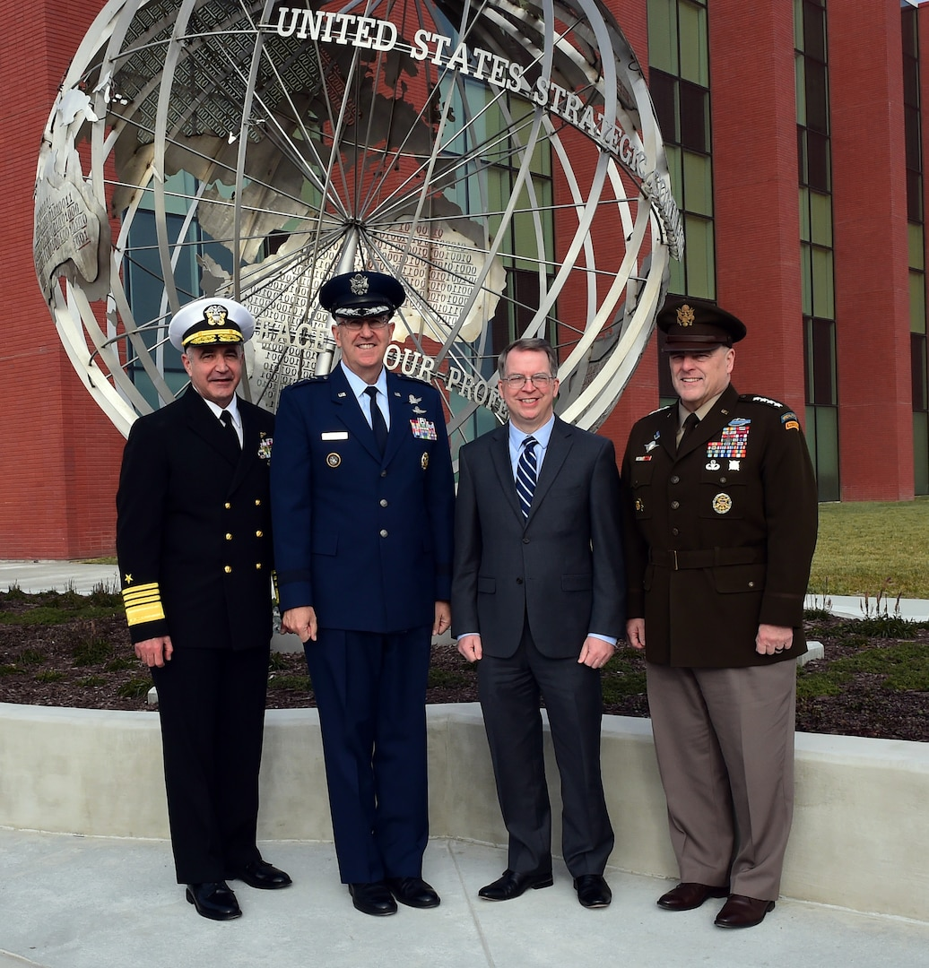 "U.S. Navy Adm. Charles ""Chas"" A. Richard, U.S. Strategic Command (USSTRATCOM) commander; Gen. John Hyten, former USSTRACOM commander; the Honorable David L. Norquist, Deputy Secretary of Defense, and Gen. Mark A. Milley, Chairman of the Joint Chiefs of Staff, pose in front of the USSTRATCOM Command and Control Facility (C2F) at Offutt Air Force Base, Neb., Nov. 18, 2019. Norquist presided over the USSTRATCOM Change of Command ceremony where Hyten turned the command over to Richard. Both Norquist and Milley lauded Richard's expertise, leadership and vision to lead USSTRATCOM into the future, and thanked Hyten for his leadership of the command over the past three years. U.S. Strategic Command (USSTRATCOM) is a global warfighting command and the ultimate guarantor of national and allied security with forces and capability that underpin and enable all other joint force operations. (U.S. Air Force photo by Master Sgt. April Wickes)"