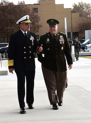 """U.S. Navy Adm. Charles """"Chas"""" A. Richard, U.S. Strategic Command (USSTRATCOM) commander walks alongside and Gen. Mark A. Milley, Chairman of the Joint Chiefs of Staff outside the USSTRATCOM Command and Control Facility (C2F) at Offutt Air Force Base, Neb., Nov. 18, 2019. Adm. Richard took command of USSTRATCOM in a ceremony at the C2F Nov. 18, at which Milley spoke and expressed his full confidence in his expertise, leadership and vision to lead the command. U.S. Strategic Command (USSTRATCOM) is a global warfighting command and the ultimate guarantor of national and allied security with forces and capability that underpin and enable all other joint force operations. (U.S. Air Force photo by Master Sgt. April Wickes)"""