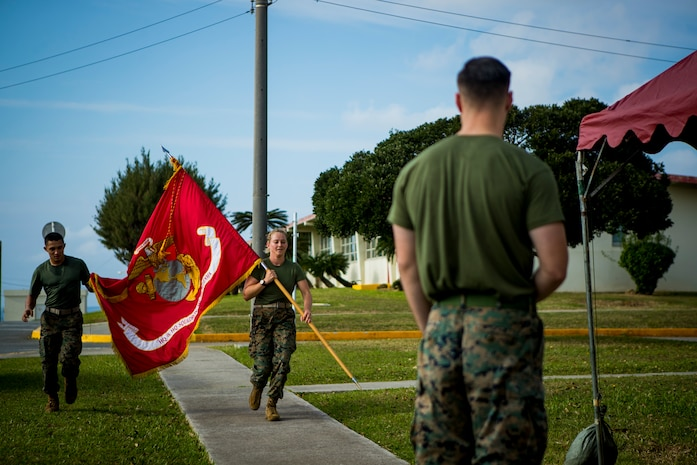 Marines with Headquarters and Headquarters Squadron, Marine Corps Air Station (MCAS) Futenma, carries the Marine Corps colors during a 24-hour motivational run celebrating the Marine Corps birthday, Nov. 7, 2019. During the run, Marines throughout the squadron reserved time to run with the Marine Corps colors to make up a collective 244 miles. (U.S. Marine Corps photo by Lance Cpl. Kindo Go)