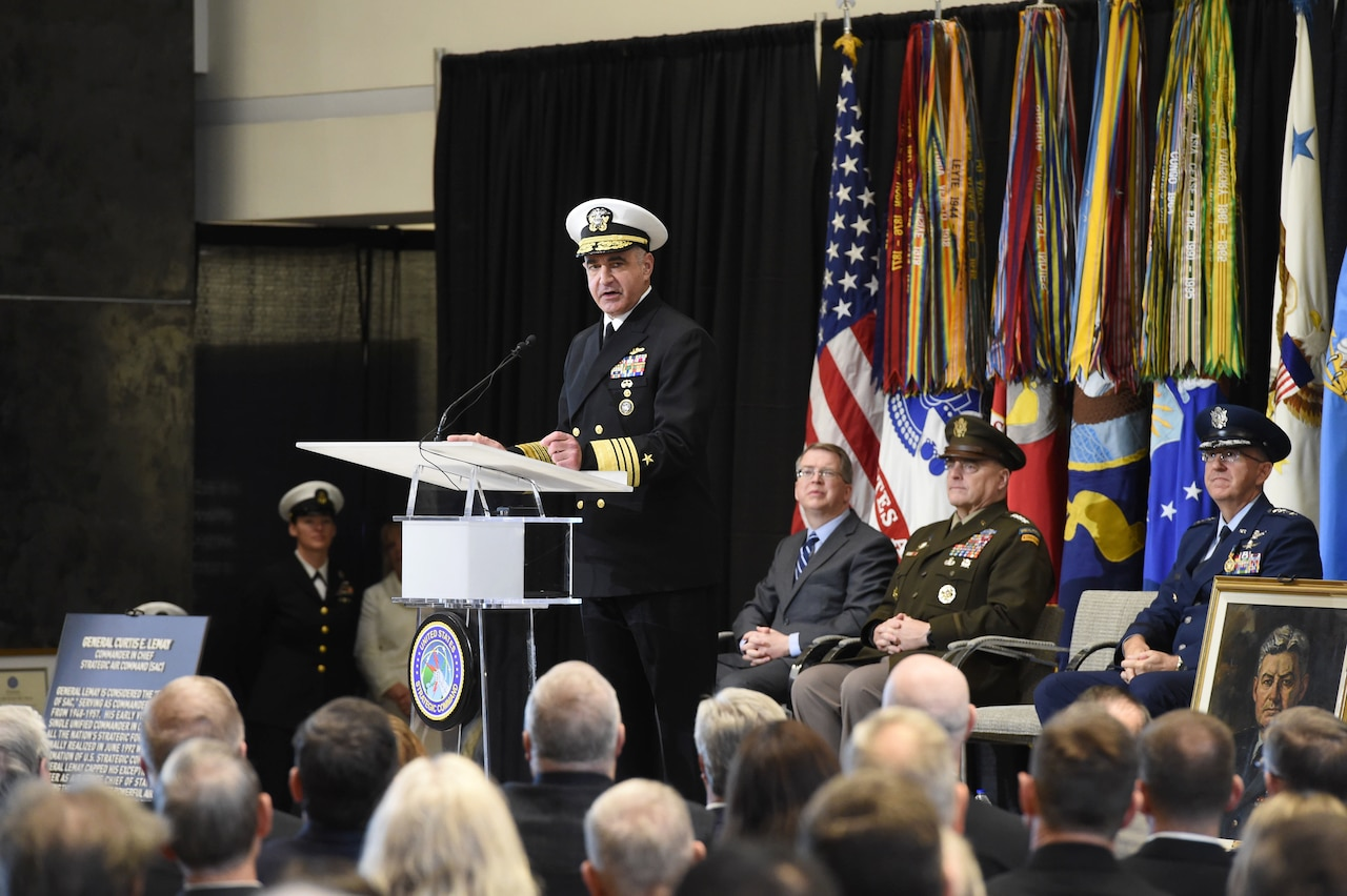 Navy Adm. Charles A. Richard speaks at a lectern in front of an audience.