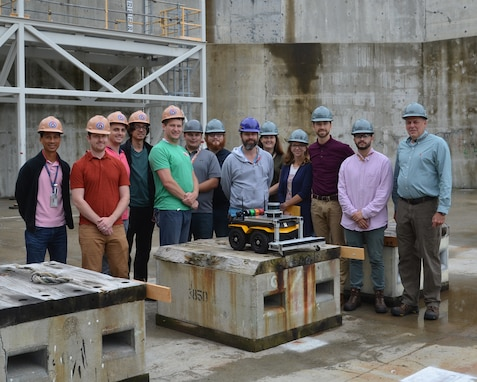 The Autonomous Dry Dock Survey robotics team pose for a group photo after a successful test.