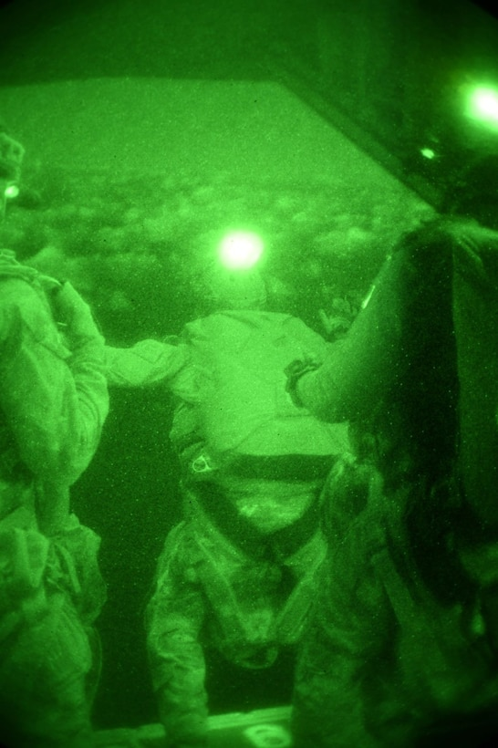 Airmen from the 320th Special Tactics Squadron perform a night jump above Wake Island, Wake Atoll, during Exercise Gryphon Pacific 20-1, Nov. 15, 2019, over the Pacific Ocean.