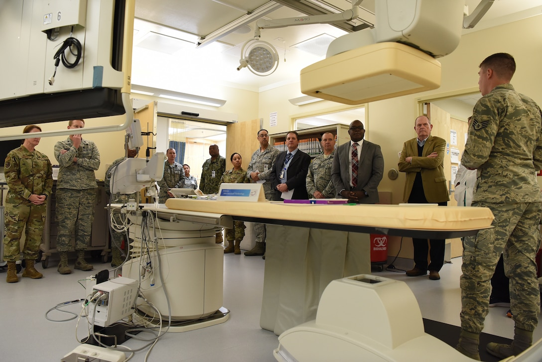U.S. Air Force Staff Sgt. Matthew Slaven, 81st Medical Operations Squadron cardiopulmonary technician, briefs 81st Medical Group staff and guests on cath lab capabilities during the cardiac catheterization laboratory ribbon cutting ceremony inside Keesler Medical Center at Keesler Air Force Base, Mississippi, Nov. 15, 2019. The lab was upgraded with an entire suite of technology to provide better and safer care for patients and the surgical team. (U.S. Air Force photo by Senior Airman Suzie Plotnikov)